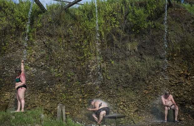 People are relaxing at the hot thermal springs in Kyndyg.