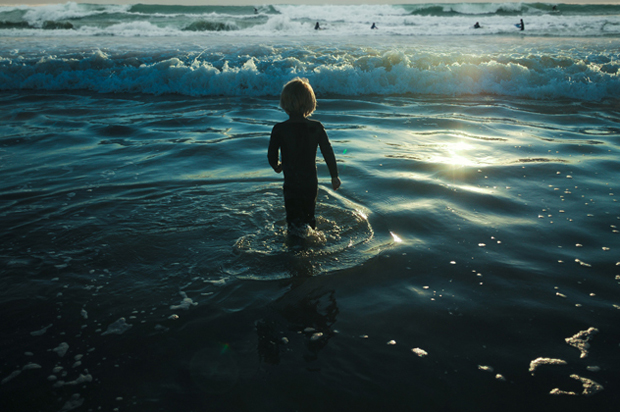 Photographer Captures Beautiful Photos of Her Young Children As They Brave the Ocean Waves