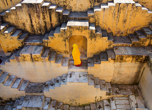 India Jaipur woman standing on steps,   water  step well.