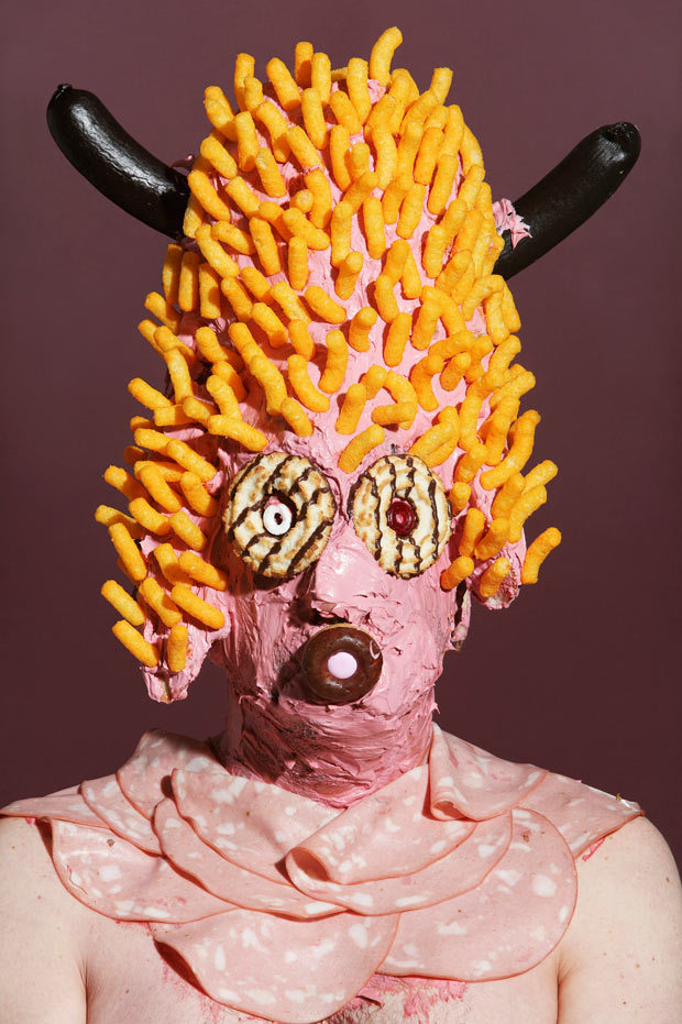 grotesque portraits of people wearing a junk food face mask
