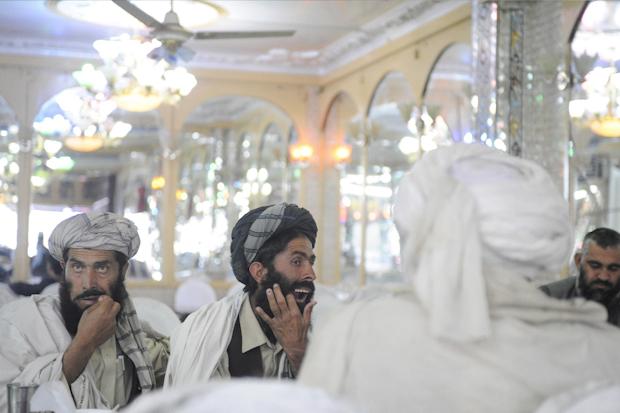 Two Pashtun men clean their teeth in a restaurantin Kabul, Afghanistan, 2010