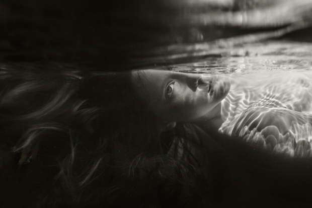 Adolescent Beauty Captured In Evocative Images of Children Swimming in the Sea
