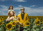 "Aug 16, 2015 - Denver, CO: Conceptual Photographer, Suzanne Heintz, beams with pride beside her imitation husband and daughter in an American Pasture.  Part of her 14 year self-portrait photo series, LIFE ONCE REMOVED, in which Heintz satirizes the image of a ""Perfect Life.""  She uses humor to comment on mid-20th Century societal expectations still present for women of a ""Certain Age"" to marry and have children. She recreates all aspects of family life with her store bought family, featuring them in scenes of blissful domestic life in and outside of the home, traditional holidays, and idyllic family vacations.  (Suzanne Heintz / Polaris)"