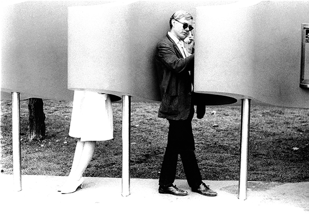 Andy Warhol on payphone at World's Fair, 1964