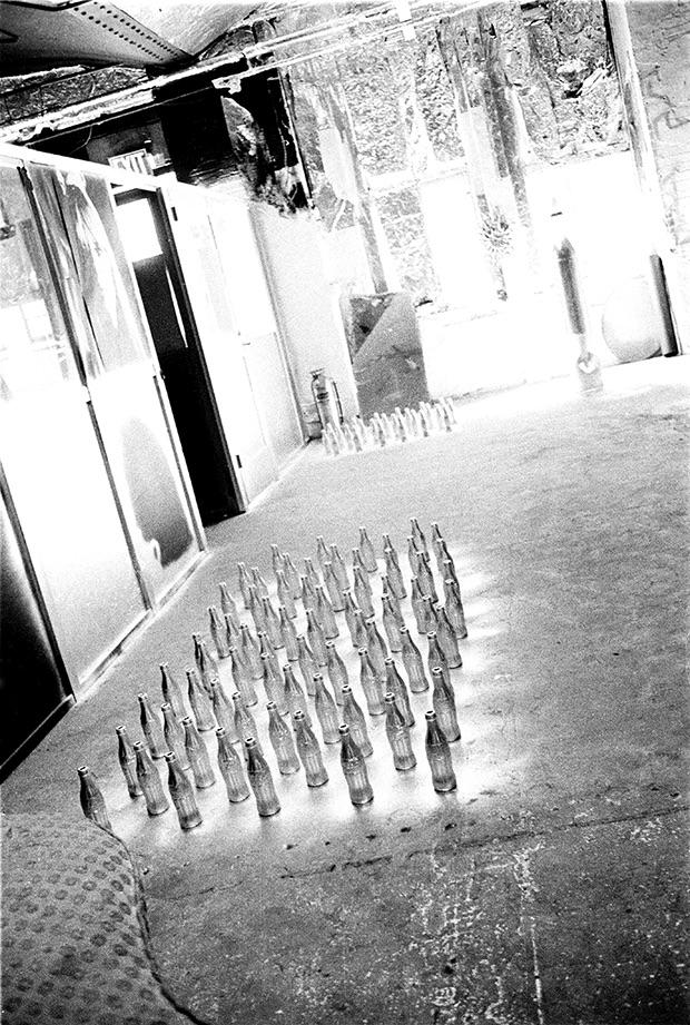Silver Coke Bottles drying on the Factory floor, 1964