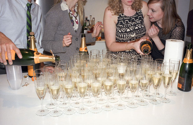 An array of champagne glasses are prepped for a New Year's Eve toast.