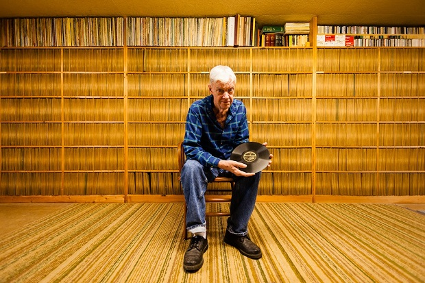 Joe Bussard - Frederick, MD Joe Bussard sitting in his basement with some of the rarest 78s in existence. The brown paper record jackets behind him are all uniformly discolored in the middle as a result of Joe's hands sorting and searching through them for the past 60 years.