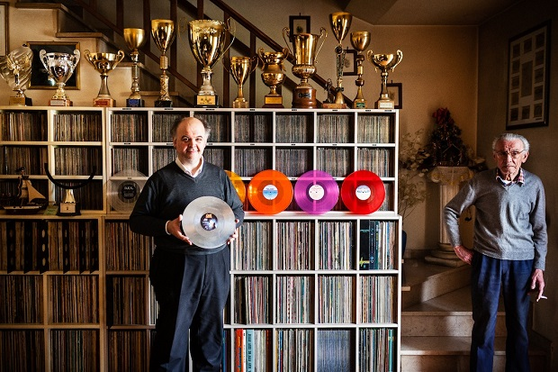 Alessandro Benedetti - Monsummano Terme, Italy Alessandro holds the Guinness World Record for largest collection of colored vinyl records. Pictured here at home with his father Marinello, Alessandro is holding a mirrored vinyl copy of Ozzy Osbourne's Bark at the Moon. Above the duo are trophies that Alessandro won playing Subbuteo, a miniature football game.