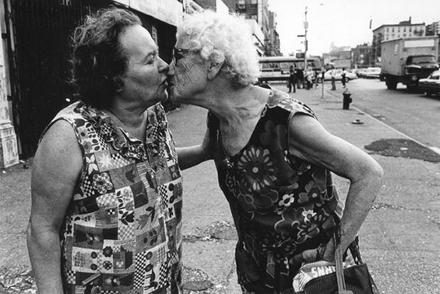 Mommie kissing Bubbie on Delancey Street, New York, 1979