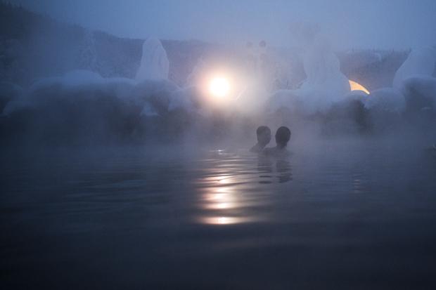 Travelers Relax in the Hot Springs in Chena, Alaska