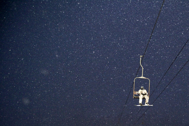 A Skier Rides a Lift at Alyeska Resort in Girdwood, Alaska