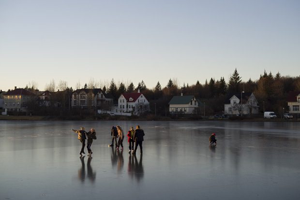 Teenagers on a Frozen Lake in Reykjavik, Iceland