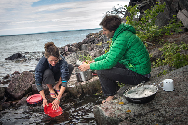 Campers Wash Dishes in Lake Superior