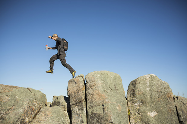 Hiker Jumping Rocks