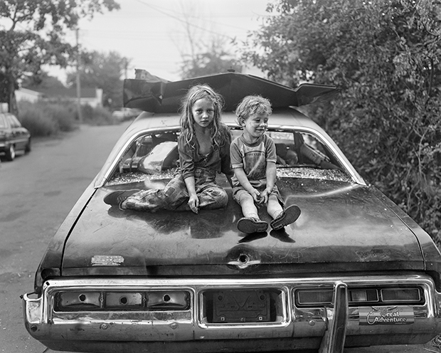 Children on Wrecked Car