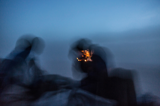 A traveler lights his cigarette after the sunset while riding on top of the iron ore train as seen on October 1st, 2015. Most of the trip through the desert is in the night time.