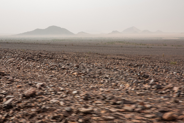 Rocky landscape seen in Zouérat region as iron ore train crosses the Sahara desert from the mine at Zouérat, in northern Mauritania, to the Nouadhibou harbor, on the Atlantic coast of West Africa, as seen on 1st of October 2015.