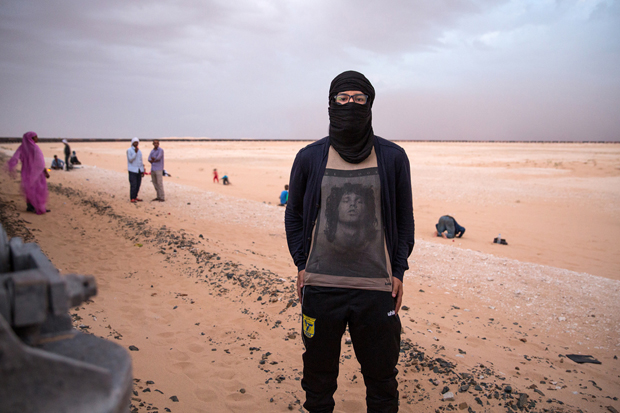Ghassem, a train mechanic and SNIM employee, poses for a portret in his Jim Morison t-shirt, during a train stop, as seen on October 1st 2015.
