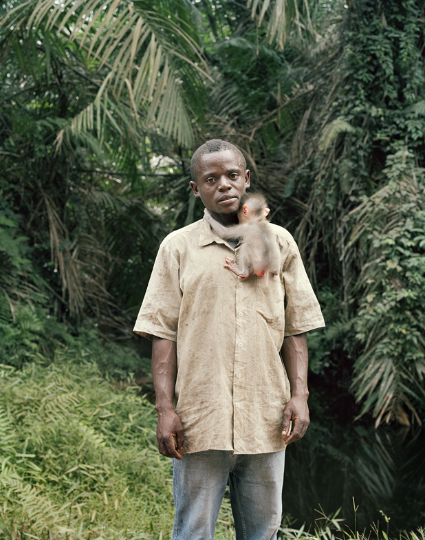 10_Man with an orphaned monkey