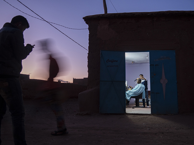 A barber at work at twilight in Ait Ben Haddou, Morooco.