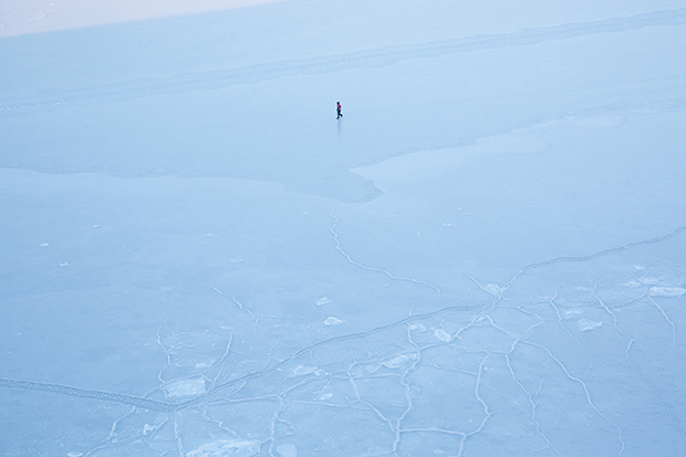 Fisherman crossing the ice