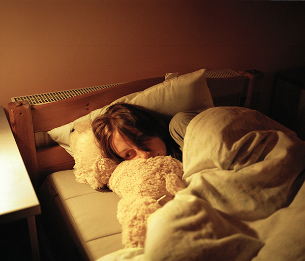 The lights are turned off at 10 PM. Karolina sleeps with a teddy bear.