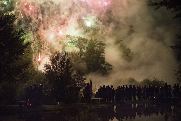 Fireworks in the sky with pond reflecting
