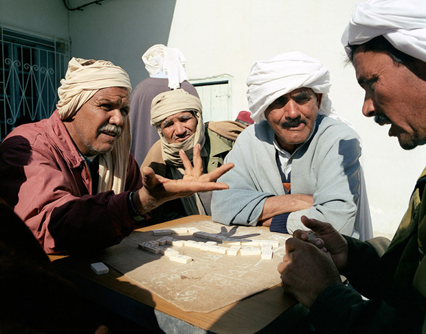 A group of Tunisian men play dominoes at Cafe Republique in Douz, Southern Tunisia , North Africa.