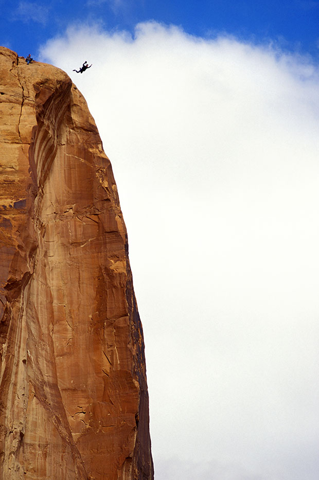 Basejumping off cliff in Moab, Utah, USA.