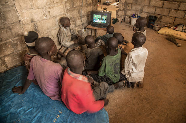 Talibes watching Tv in a room in a Daara in the periphery of Dakar. These so-called educational centers accommodate from 30 to 100 boys, who are packed into rooms and made to sleep on the floor, often living in squalor. As of 2010, an estimated 200,000 boys had become talibes in Senegal.