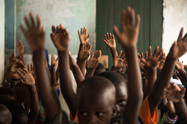 Children singing during a classroom in a Koranic School in Saly, Senegal.