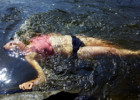 A women cools down in a river.