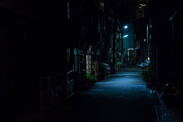 OSAKA, JAPAN - DECEMBER 29, 2015: Dark back street at night in J
