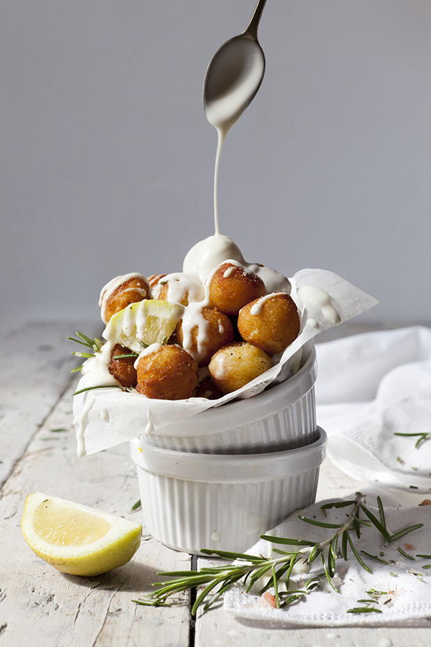 balls of fried potatoes with lemon, rosemary and dripping sauce