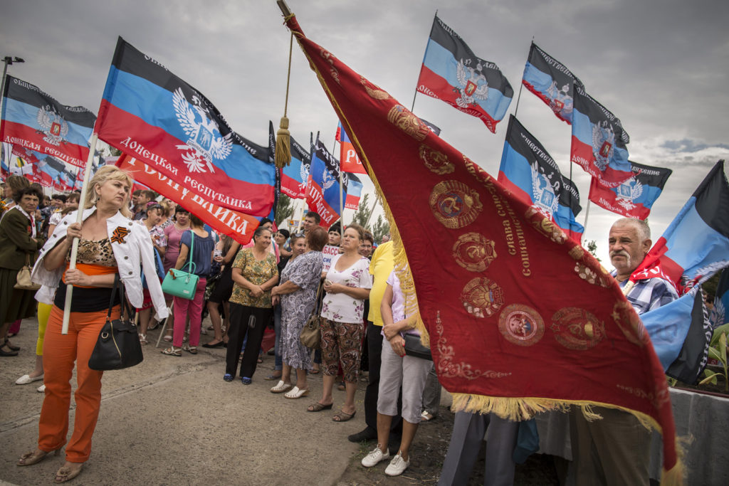 "Remarkable & immediate addiction to the Soviet traditions and celebrations in Soviet style has stricken Donetsk People Republic. People holding Soviet and DNR flags at the Soviet era-style decorated official celebrations in anniversary of ""2nd liberation of Donbas from the fascists"", September 09 2015 Photographer: Dmitri Beliakov/ for Stern"