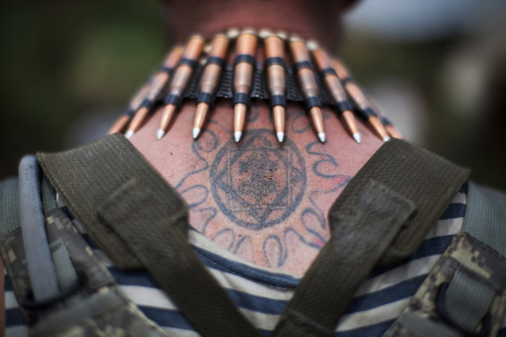 Ukrainian soldier with bullets around his neck, June 24th 2015, East of Ukraine, Photographer: Dmitri Beliakov/ for Sunday Times
