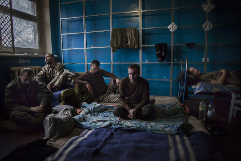 Ukrainian POWs in their cell on the grounds of a separatist base, February 03 2015, Donetsk, East of Ukraine Photographer: Dmitri Beliakov/ for Russian Reporter Magazine