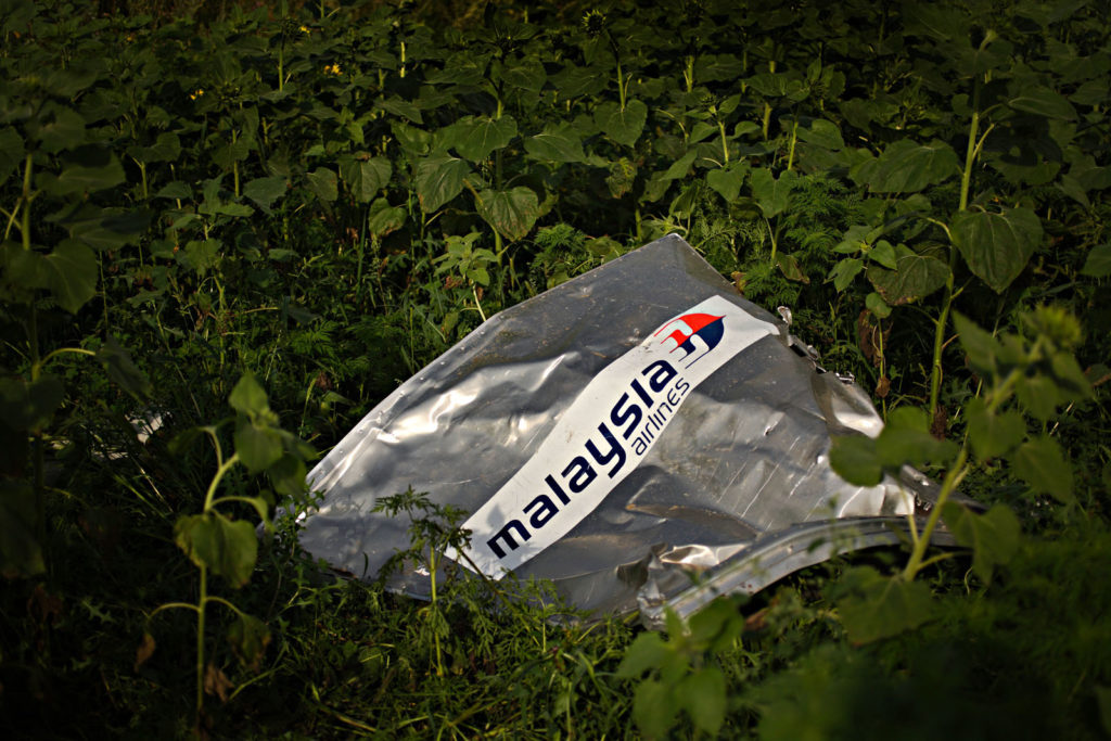 Parts of MH17 fuselage seen on the crash-site nearby Grabovoye village, July 19 2014, Grabovoye, Ukraine Photographer: Dmitri Beliakov/ for Stern