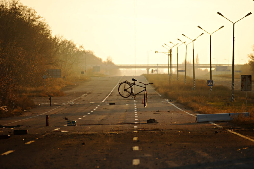 A bicycle hangs by a string from a bridge on rebel held territory on the main road to the Donetsk international airport, November 9 2014, Eastern Ukraine.