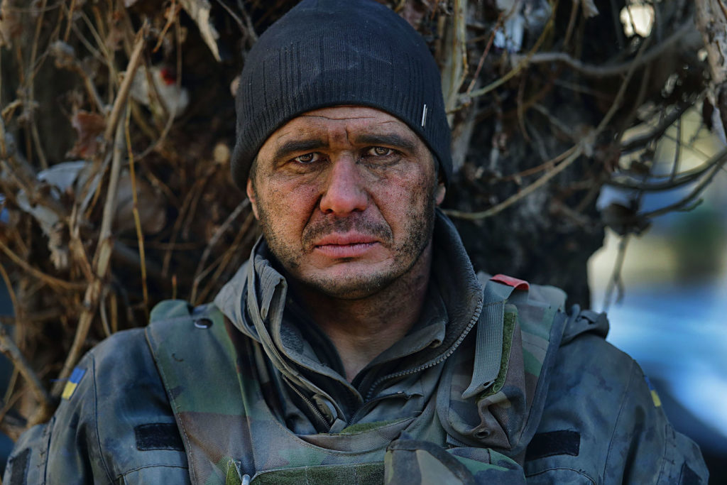 A Ukrainian soldier seen after breaking out of a siege by pro-Moscow separatists in Debaltsevo. The battle for strategically important railway junction Debaltsevo was one of the fiercest of the entire war in Eastern Ukraine and resulted in a defeat for the Ukrainian army, Artyomovsk, Ukraine, February 18 2015. Photographer: Dmitry Beliakov/ for Der Spiegel