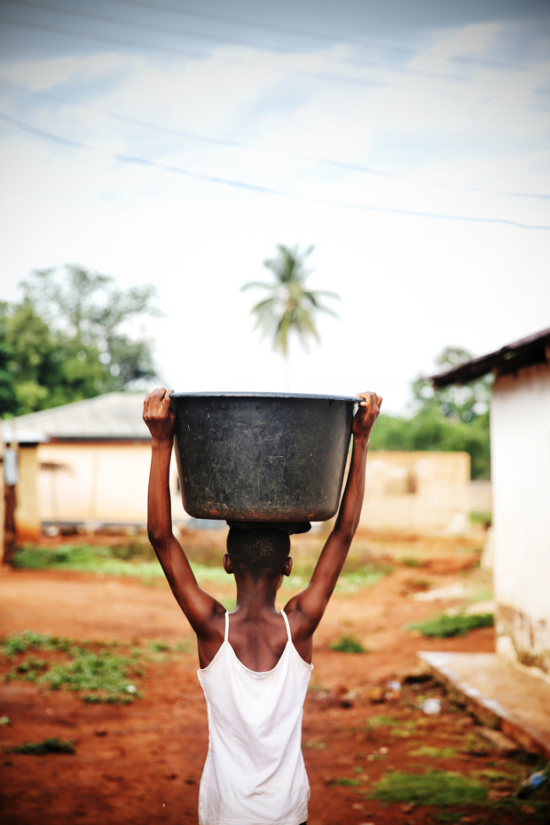 Patience carries water back to the house from the well. It is a roughly 5 minute walk to the well from her house and she makes this journey 3-4 times every day after school.