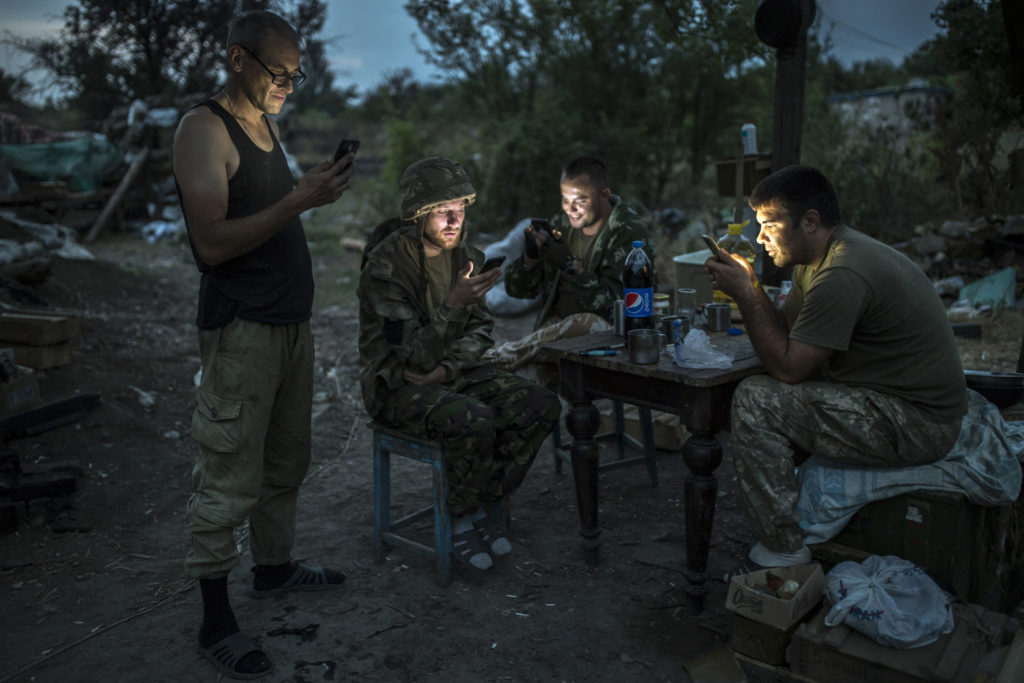 Ukrainian soldiers seen on the base. Everyone is a gadget user to communicate with the family, August 24 2016. Photographer: Dmitri Beliakov