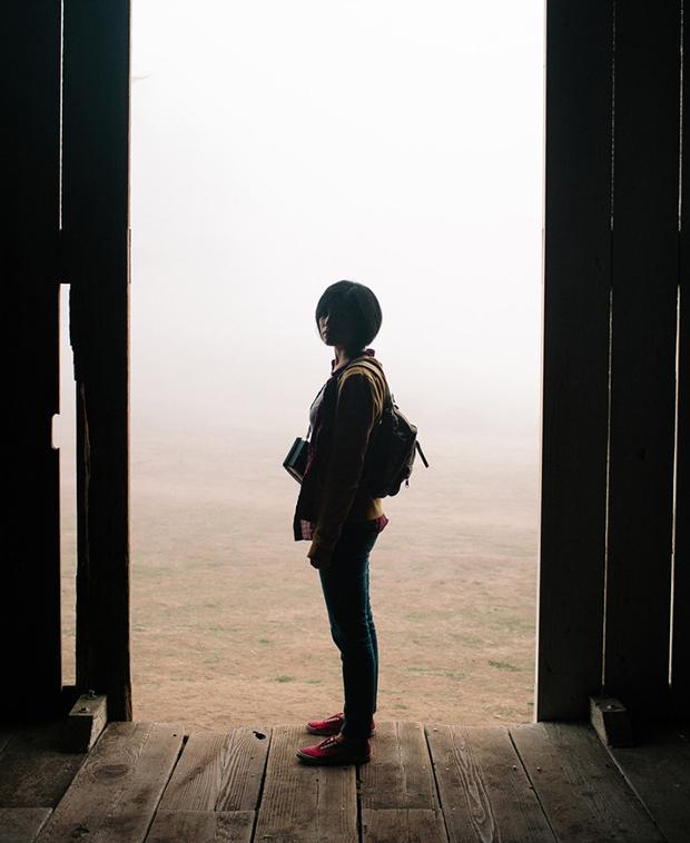 Woman in barn doorway