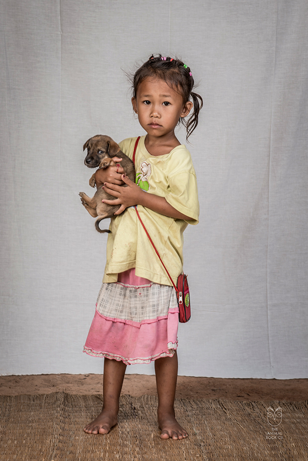 Portraits of People and their Dogs in Rural Laos